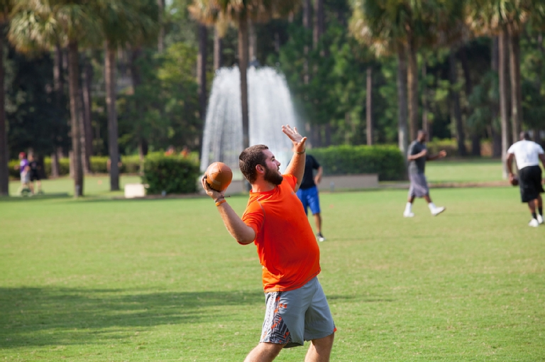 Student Throwing Football