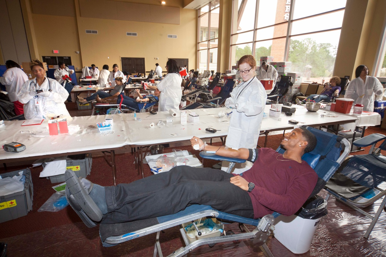 Students give blood at annual footbal team blood drive